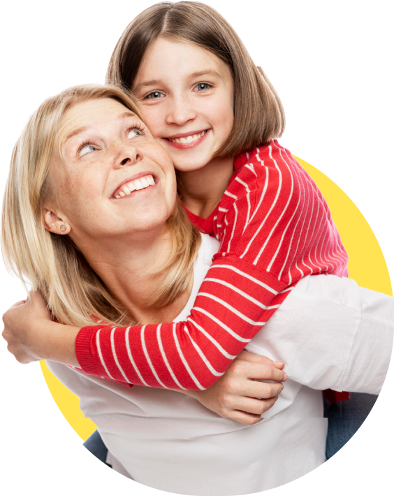 A foster child and her foster mum smiling whilst little girl in red striped top has a piggyback