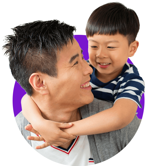 Foster dad with his son having a piggyback