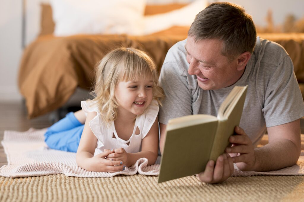 foster parents and foster children reading together on the floor