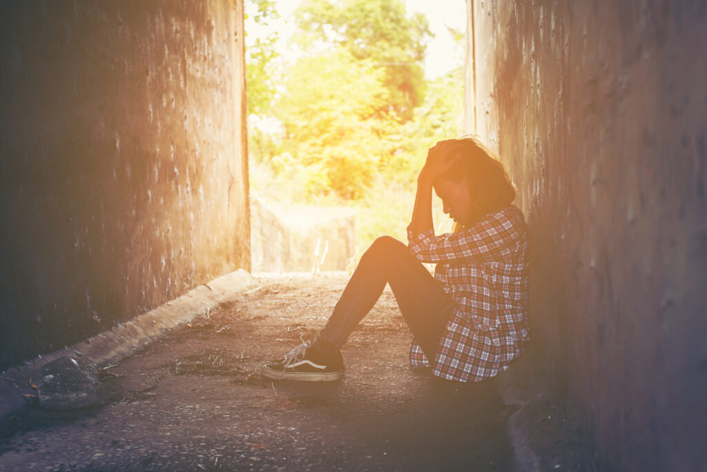 sad woman hug her knee and cry feeling so bad,loneliness,sadness,nobody here.